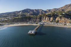 Malibu Pier Aerial with Pacific Ocean and Santa Monica Mountains. Aerial of the historic Malibu Pier, beaches and the Santa Monica Mountains on the Southern Royalty Free Stock Image