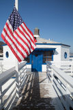 Malibu pier and american flag. Detail of white pier in Malibu (L.A.) and American flag Royalty Free Stock Photo