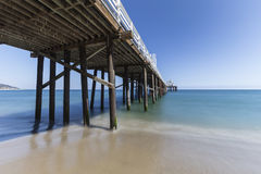 Malibu Pier Beach with Motion Blur Pacific Ocean Water. Near Los Angeles in Southern California Stock Photos