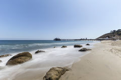 Malibu Pier Beach with Motion Blur Surf Stock Photography