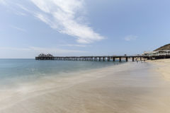 Malibu Pier Beach with Motion Blur Water in Southern California. Malibu Pier beach with motion blur water in Los Angeles County, California Stock Images