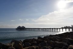 Malibu Pier. Stretching out into the ocean in the late afternoon Stock Photos