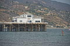 Malibu Pier. With surfers and pelicans Stock Images