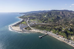 Malibu Pier and Surfrider Beach Aerial. Aerial view of Malibu Pier, Surfrider Beach and the Santa Monica Mountains in Southern California Stock Photo