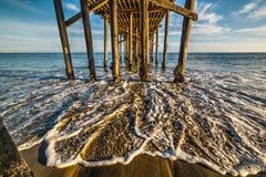 Malibu pier wooden poles Stock Photo