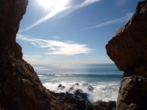 Malibu Rocks. Crashing surf framed by a Malibu California rock formation Stock Images