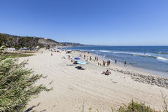 Malibu Summer Scene. Malibu, California, USA - August 15, 2015: Summer weekend beach goers enjoying Topanga State Beach in Santa Monica Bay Stock Photos