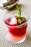 Malibu Sunset Cocktail with mint leaves. Beverage Concept Stock Images