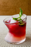 Malibu Sunset Cocktail with mint leaves. Stock Photos