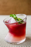 Malibu Sunset Cocktail with mint leaves. Royalty Free Stock Images