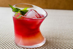 Malibu Sunset Cocktail with mint leaves. Royalty Free Stock Photos