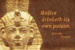 Own poison Ancient Egypt. Malice drinketh its own poison - Ancient Egyptian proverb printed on textured background with sculpture relief stock photo