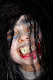 Malicious grin of vampire boy. Closeup face photo Royalty Free Stock Photos