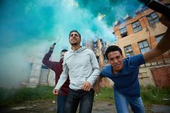 Malicious hooligans. Portrait of furious dudes making rebel in ghetto Royalty Free Stock Images