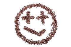 Malicious smile smiley coffee beans isolated on a white background.  Stock Photo