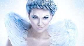 Malicious snow queen. Beautiful snow queen with malicious smiling Royalty Free Stock Photo