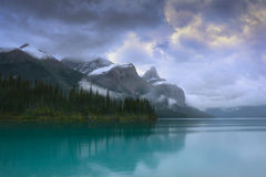 Malign Lake Canada with mountain reflection. In aquamarine water Stock Photos