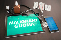 Malignant glioma (cancer type) diagnosis medical concept on tabl. Et screen with stethoscope Royalty Free Stock Photo