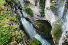Maligne Falls through the narrow Maligne Canyon. View of one of several Maligne Falls through the narrow Maligne Canyon in Jasper National Park, Alberta, Canada Royalty Free Stock Image