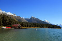 Maligne Lake Boat House, Jasper Alberta. Boat house and canoes along Maligne Lake , Jasper Alberta Stock Photo