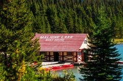 Maligne lake boat house. The malign lake boat house thru the trees at malign lake Royalty Free Stock Image
