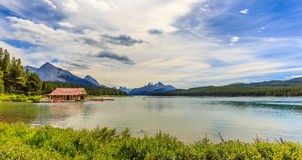 Maligne Lake Boathouse. Valemount, BC Canada - AUGUST 10, 2014: The historic Curly Philips Boathouse on Maligne Lake, in Jasper National Park Stock Photography