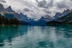 Maligne Lake, Canada. The beautiful turquoise blue of the Maligne Lake in Canada with the mountains in the background stock image