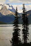 Maligne lake in the Canadian Rocky Mountains. Canoeists in the distance on Maligne Lake in the Canadian Rocky Mountains Royalty Free Stock Photos