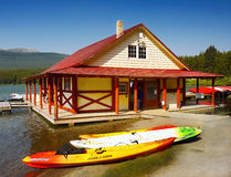 Maligne Lake Jasper. Boat rental and colorful kayaks on Maligne Lake shore in Jasper National Park, Canada Royalty Free Stock Photography
