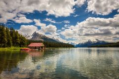 Maligne Lake in Jasper National Park. Boat house and the idyllic Maligne Lake in Jasper National Park, Canada, with snow-covered peaks of canadian Rocky Stock Image