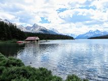 Maligne lake in Jasper national park, with calm and still waters and a handful of rowboats for tourists to rent royalty free stock photo