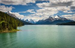 Maligne Lake in Jasper National Park. Idyllic Maligne Lake in Jasper National Park, Canada, with snow-covered peaks of canadian Rocky Mountains in the background Royalty Free Stock Photo
