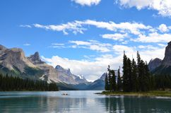 Maligne Lake kayakers. JASPER, AB / CANADA - JULY 23, 2017: Kayakers explore Maligne Lake in Jasper National Park Royalty Free Stock Images
