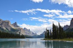 Maligne Lake kayakers. Kayakers paddle in Maligne Lake in Jasper National Park Royalty Free Stock Photo