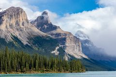 Maligne Lake. 8 SEPTEMBER 2016, JASPER NATIONAL PARK, ALBERTA, CANADA: A scenic view of Maligne Lake on a beautiful late summer day Royalty Free Stock Images