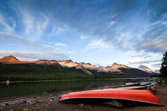 Maligne Lake at Sunset - red boats in Jasper NP, Canada. Maligne Lake at Sunset - red boats in Jasper National Park, Alberta Canada Royalty Free Stock Photos
