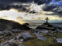 Malin head. Sea coast cross sunset greens and blues and the beauty of ireland Royalty Free Stock Photos
