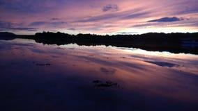 Malin town inlet. Sunset reflection on sea Stock Photo