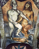 Malinche and Cortes. Mural entitled Cortes y la Malinche (Cortez and Malinche) by Jose Clemente Orozco under the stairwells of the San Ildefonso College in the Stock Image
