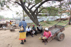 Malindi's street. To Malindi in Kenya some men sitting under a tree are talking among themselves stock photos