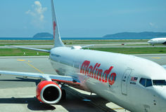 Malindo airlines in Kota Kinabalu Internation Airport. KOTA KINABALU INTERNATIONAL AIRPORT, KOTA KINABALU, MALAYSIA - MAY 09: Malindo airlines plane landed at Royalty Free Stock Photography