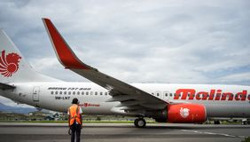 Malindo Airlines and maintenance staff who doing his job, Bandung Indonesia. A maintenance office have checked engine before taking off from airport to Bandung Stock Photography