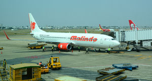 Malindo airplane parking at the airport. A Malindo airplane parking at the airport in Saigon, Vietnam Stock Images