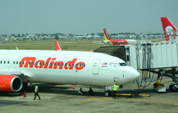 Malindo airplane parking at the airport. A Malindo airplane parking at the Tan Son Nhat airport in Saigon, Vietnam Royalty Free Stock Image