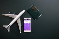 Malindo. Kuala Lumpur,Malaysia 19th Jun 2016,Malindo airline mobile apps with toy aeroplane Royalty Free Stock Photos