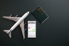 Malindo. Kuala Lumpur,Malaysia 19th Jun 2016,Malindo airline mobile apps with toy aeroplane Stock Photo