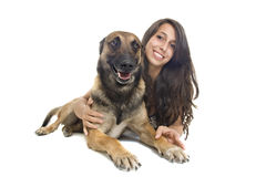 Malinois and girl. Purebred belgian sheepdog malinois with young girl on a white background Royalty Free Stock Photography