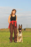 Malinois and woman. Young woman and her purebred belgian sheepdog malinois Stock Images