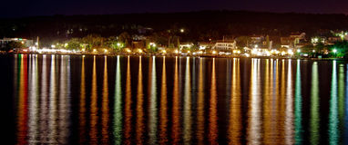 Malinska night - reflections on the Sea. Light reflecting on sea surface, Malinska, Island of Krk, Croatia Royalty Free Stock Images