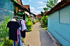 Malioboro district. Drying clothing at tiny asian street Stock Images